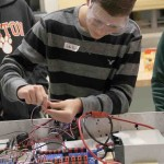 Freshman Luke English puts wires together on the robot in preparation for the team's upcoming competition that will take place March 6-8 at Kettering University.