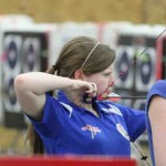 Pulling back on her bow, senior Hunter Hauk aims for the target. Hauk has been practicing archery since 2009 and is hoping to attend the 2016 Summer Olympics.