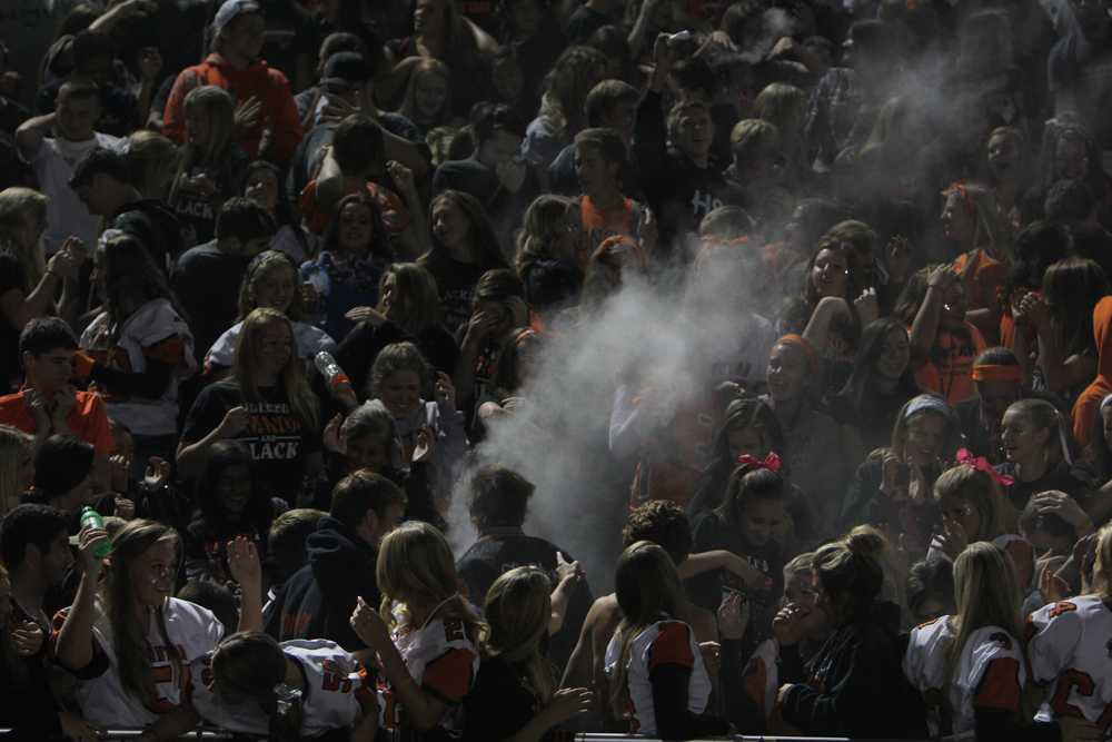 Students react to the white out caused by baby powder during half time of the homecoming game.