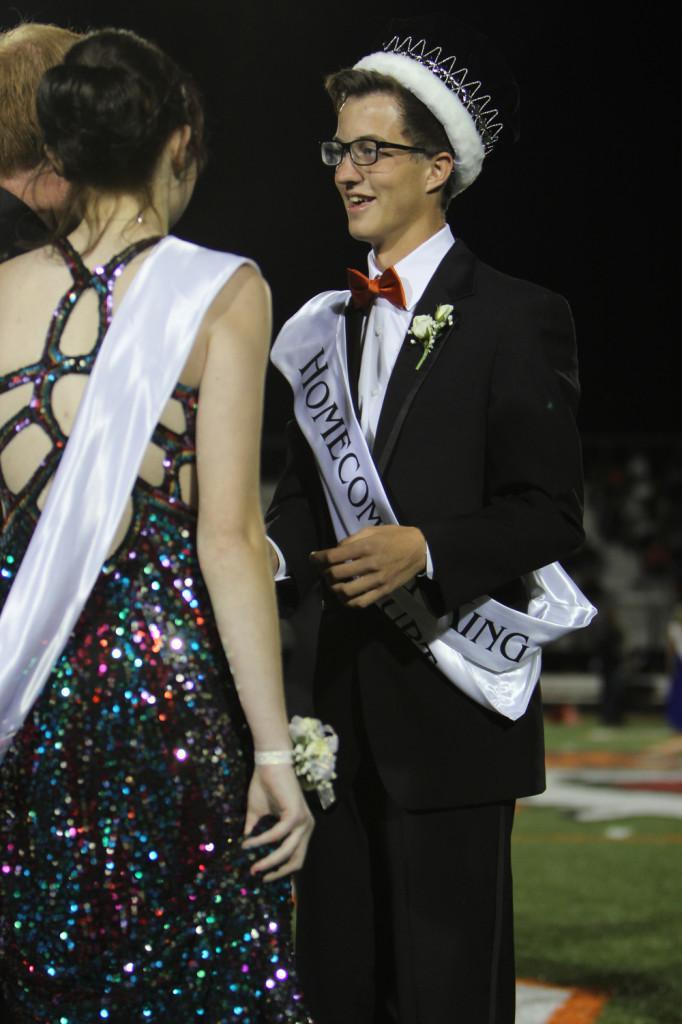 Senior Jack Pooler is crowned Homecoming King by Savannah Hourigan in honor of her brother Jessi Hourigan.