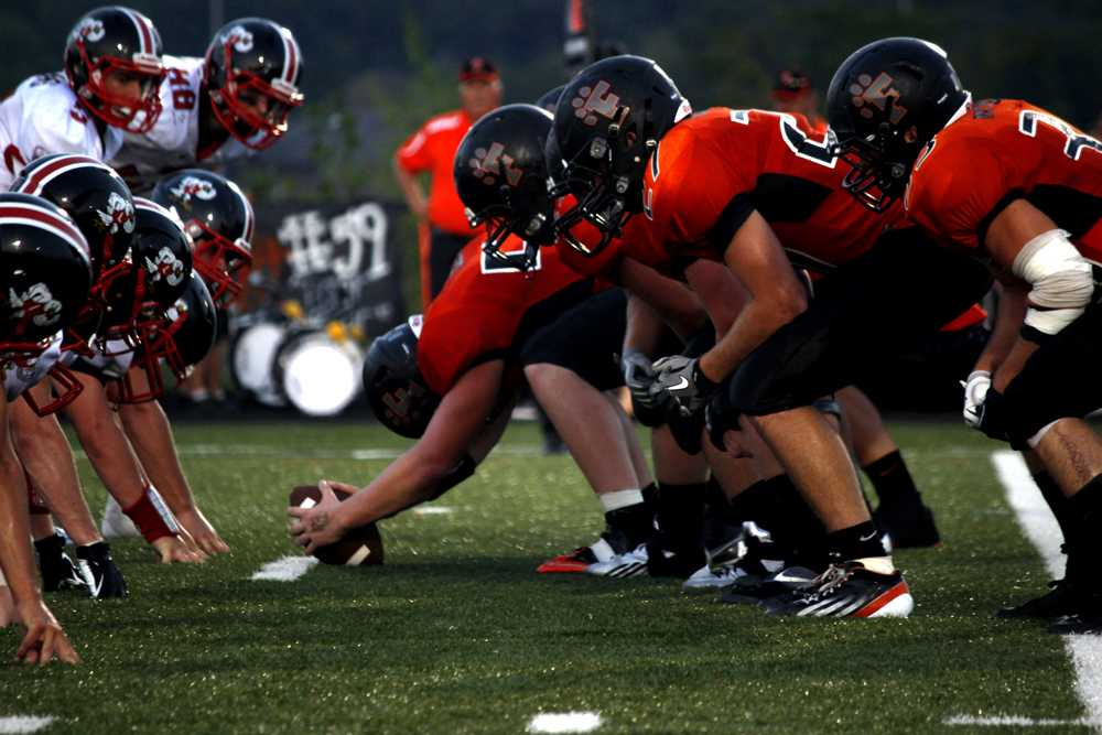 Fenton's offensive line squares off with rivals from Linden. The Tigers won the contest.