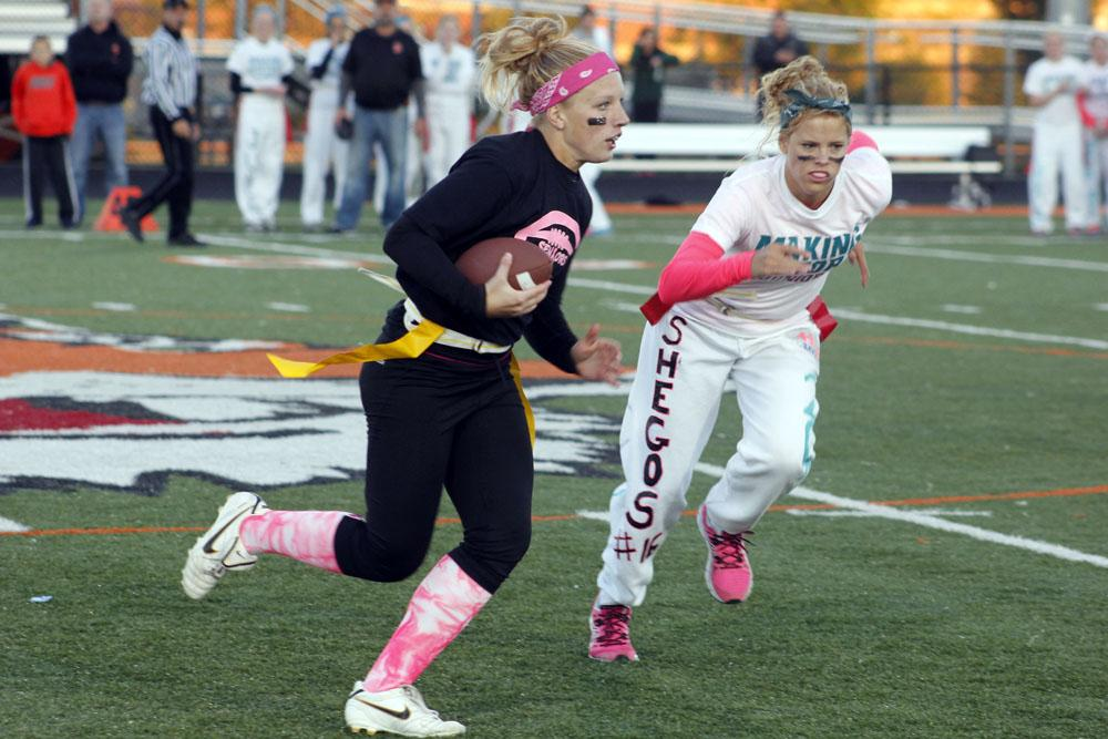 Senior Ellie Cowger runs the ball down the field for the seniors.