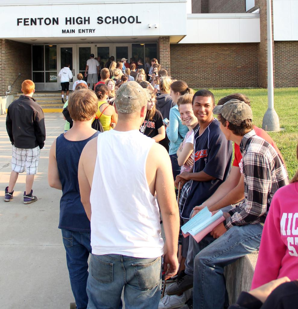 Patiently waiting. Seniors line up early in the morning to receive their schedules and purchase their assigned parking spot. Fenton High rose the price $5 for the 2013-2014 school year to repaint numbers in the student lot.