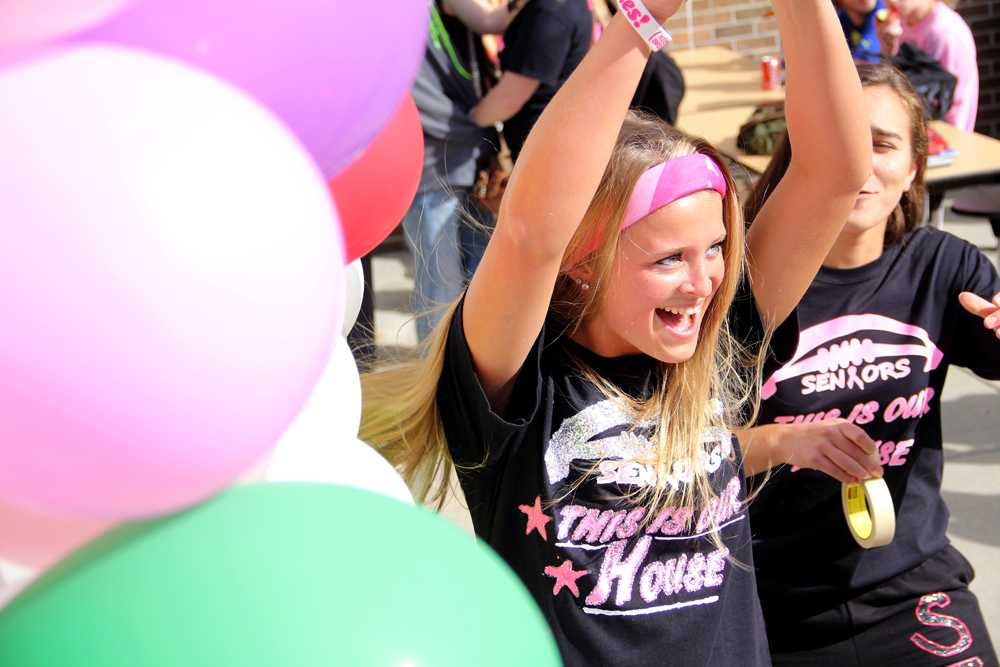Senior Tori Chapin celebrates at the lunch games hosted by the Yearbook staff. The games included pin the tail on the Tiger and popping balloons to try and win a prize.