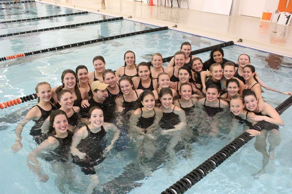 The Fenton Girls Swim and Dive Team celebrate their Metro League win with their coach