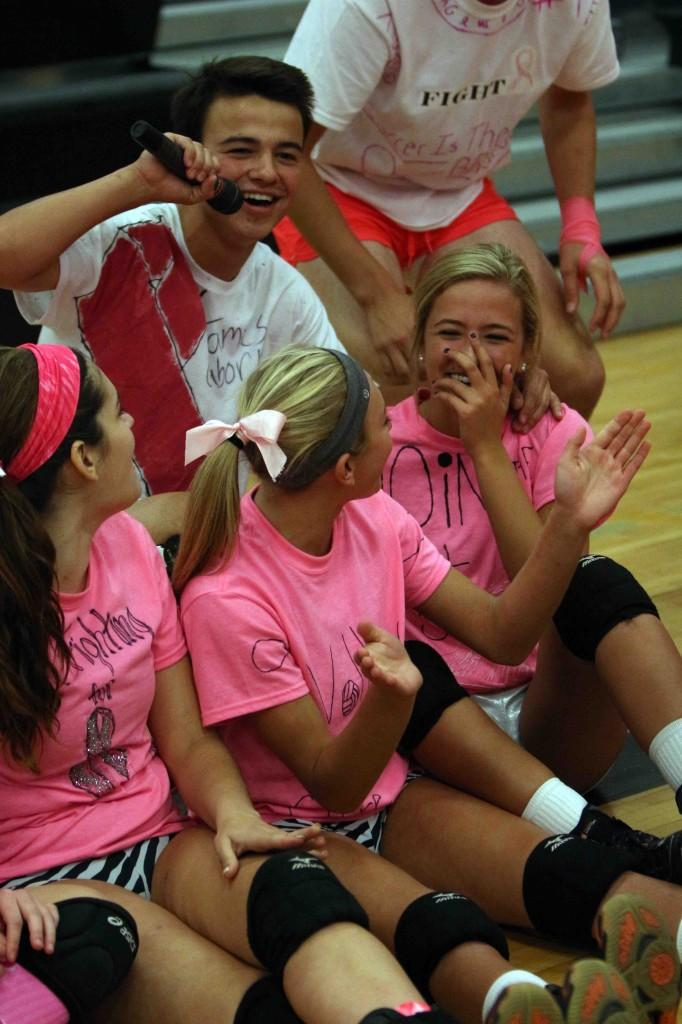 The volleyball and soccer teams had a lot of fun playing against each other in a volleyball game supporting breast cancer