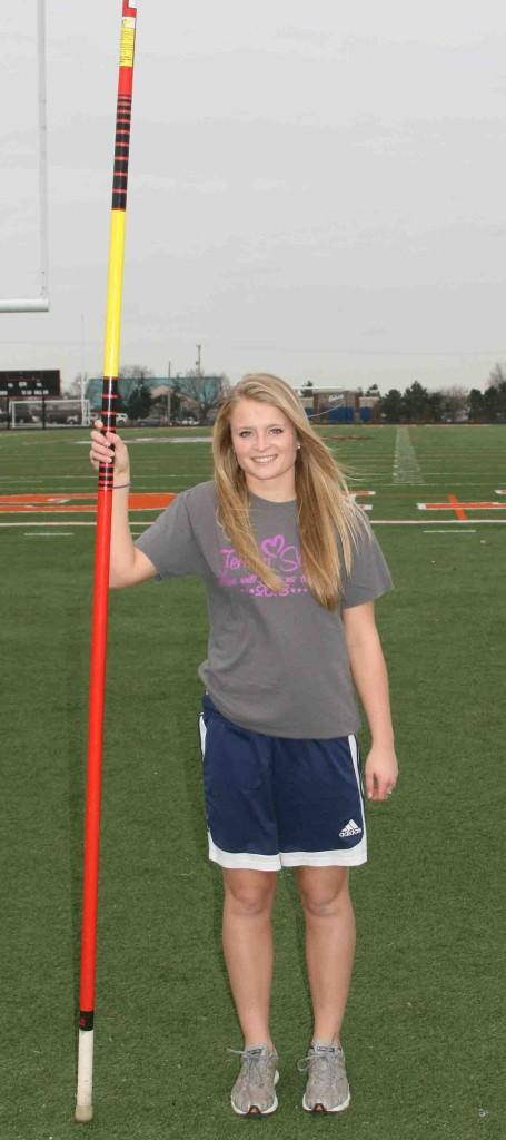 Vaulting with a 4.0. Posing with her pole, senior Tori Chapin pole-vaults all year. While vaulting, Chapin is able to maintain a spot in the Top 10 of the class of 2014.