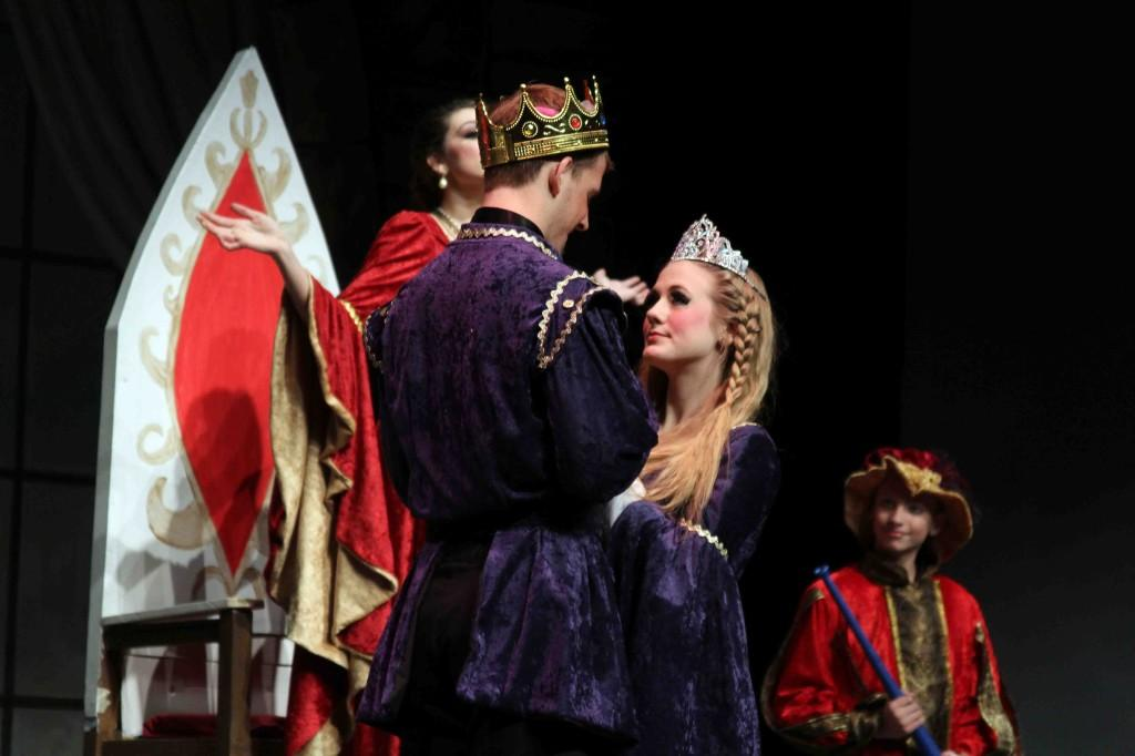 Holding hands senior Michael Van Camp and junior Amanda Blumenschein look into each others' eyes while preforming on stage.