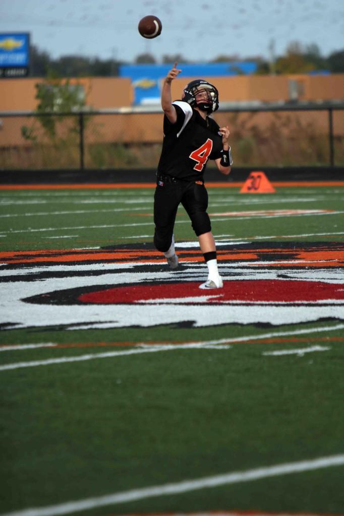 Freshman quarterback passing to his reciever