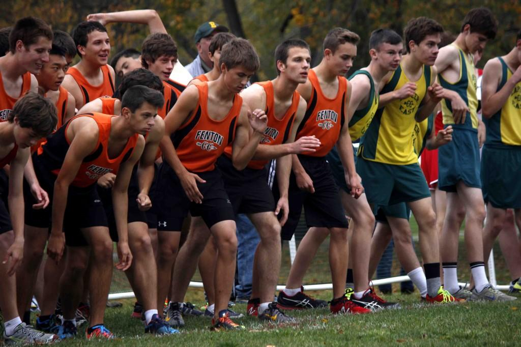 The Fenton Boys Cross Country team waits anxiously for the race to begin at the Holly Invitational