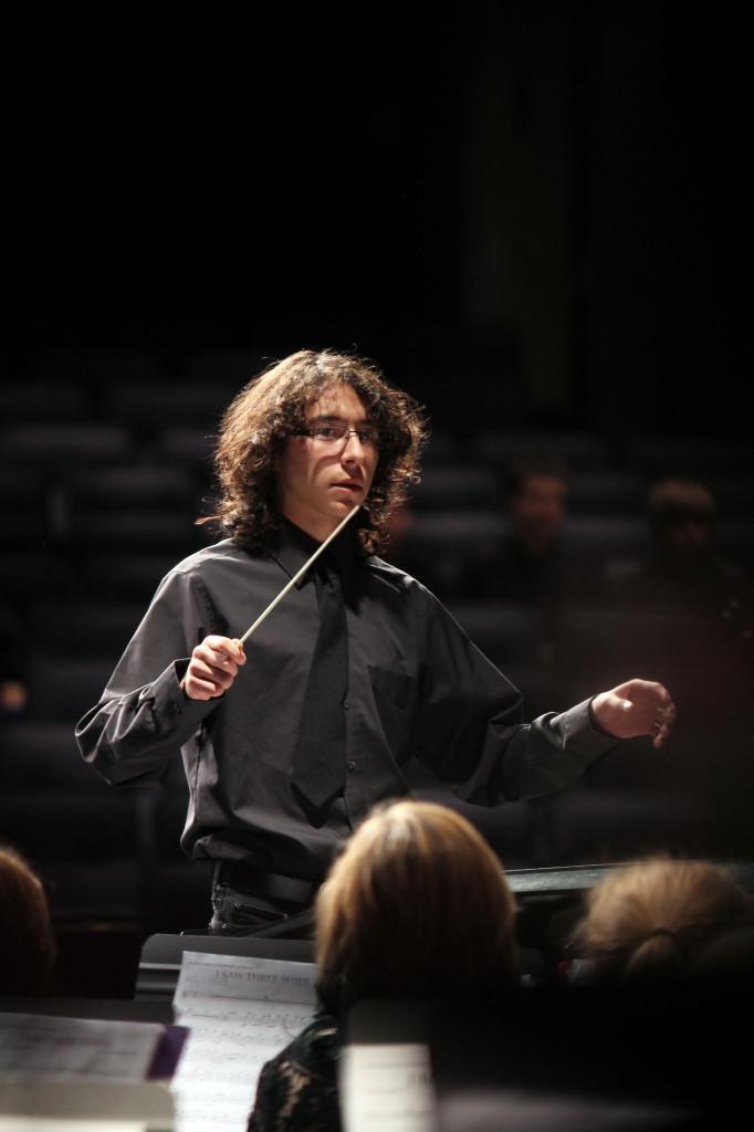 Junior Antonio Caballero conducting the wind ensemble to the song