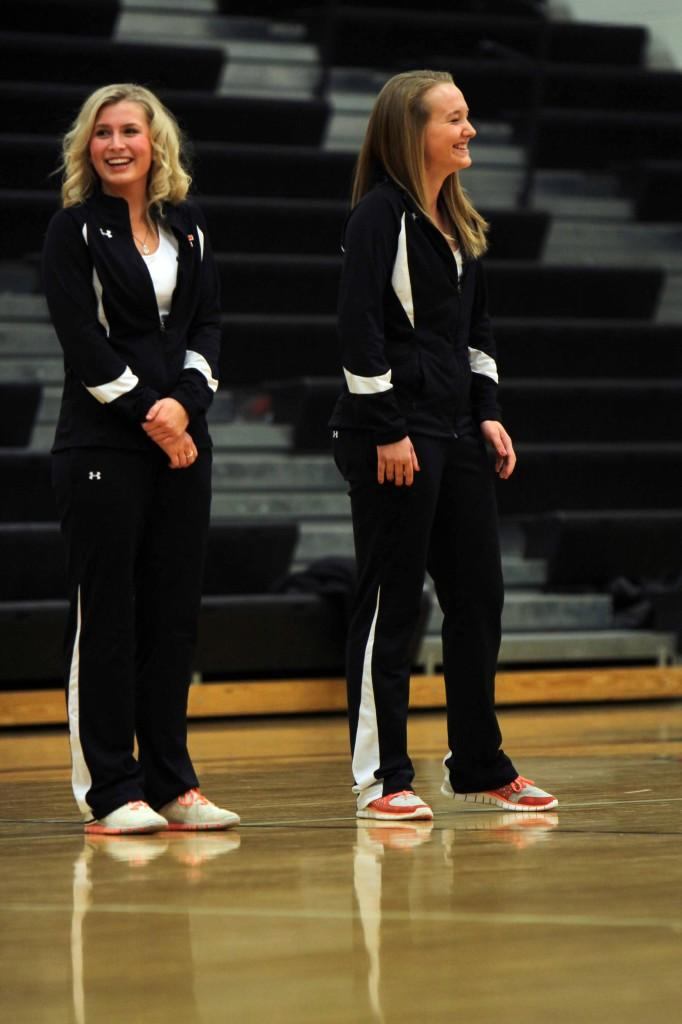 Sophomore Madison Shegos and freshman Logan Carter laughing after their coach told them to spread out.