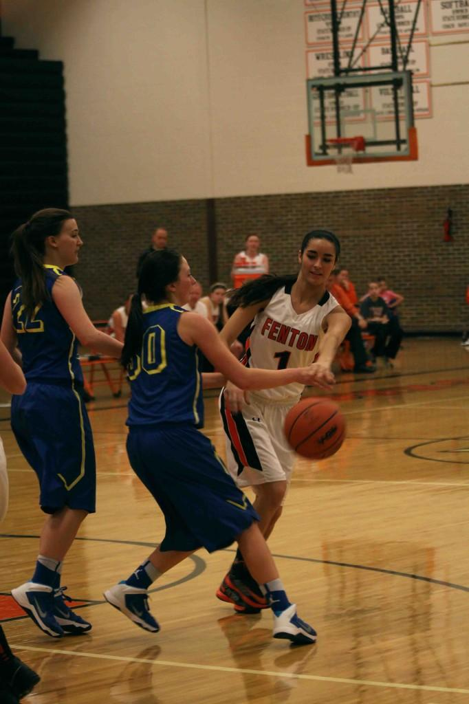 Dribbling around the Kearsley defense, junior Katie Conroy contributes to the Tiger's 54-25 over the Hornets.