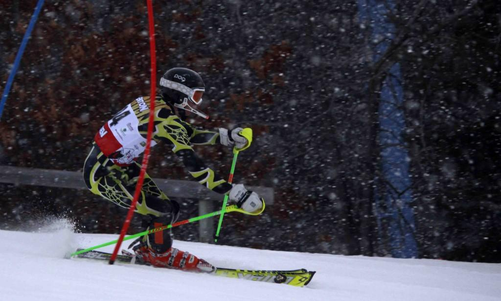 Returning ski team member  Seth Thompson weaves between check points during a meet at Mt. Holly.