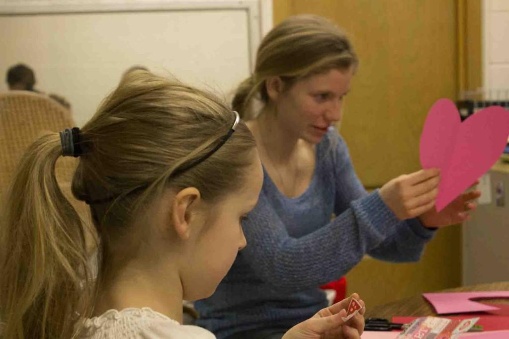 Creating Valentine's Day cards with elementary students, senior Emily Bemis mentors younger students for a year long Mentor Training project.