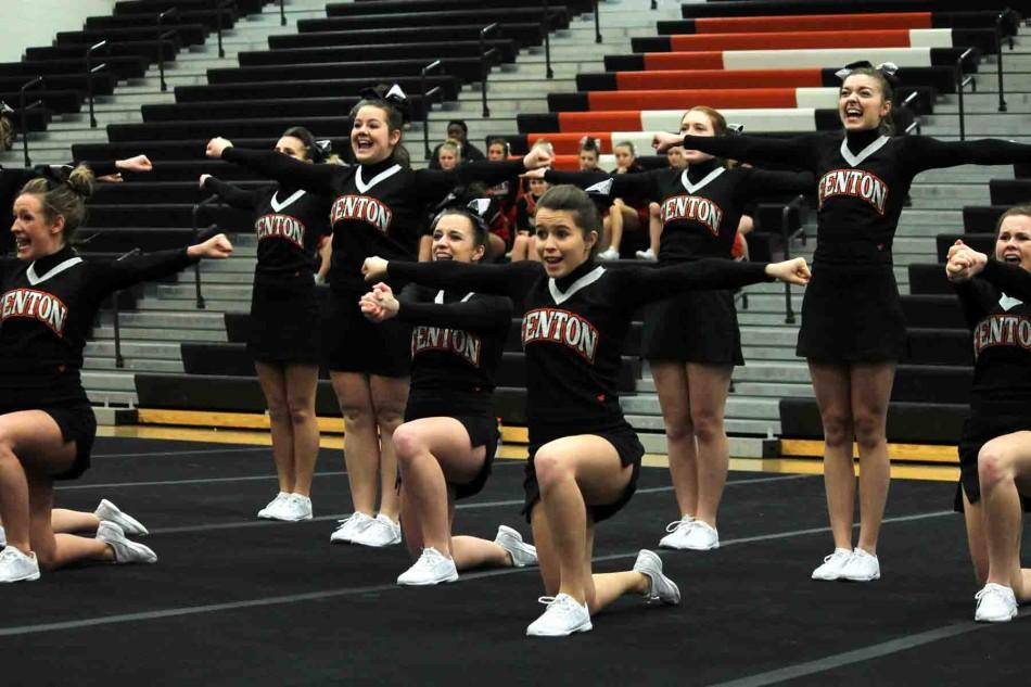 """Performing a routine at a home competition, senior Mallory Lockwood stretches her arms out straight to make an impact on the judges. """"We were fifth in the Metro League the past two years,"""" Lockwood said. """"I have done cheer for a long time and I am really going to miss all the girls I cheered with."""""""