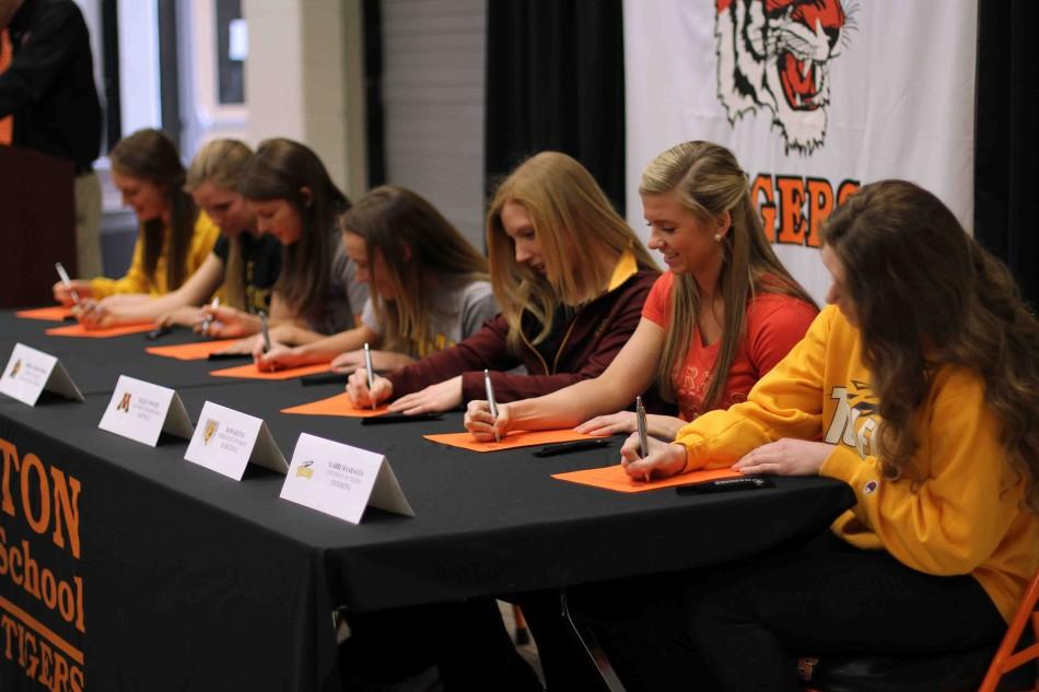 FHS athletes are all smiles as they celebrate their athletic accomplishments an dedication at a college signing.