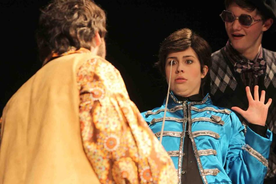 """Sword pointed at her face, senior Julie Siefker surrenders during IB theater's performance of Twelfth Night. """"I enjoyed growing as an actress,"""" Siefker said. """"The most difficult part of playing the part of a man was picking up on boy's mannerisms."""""""