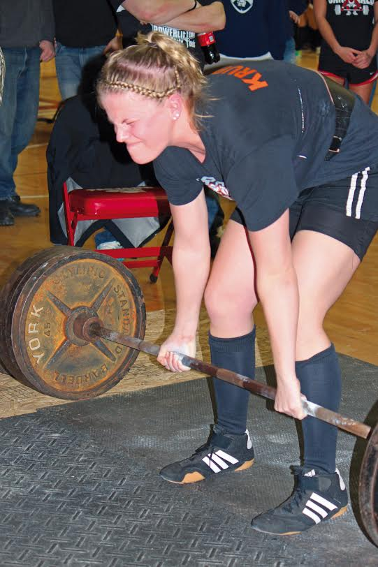 With+the+face+of+focus+and+concentration%2C+senior+Crystal+Krupp+makes+an+effort+to+lift+the+bar+at+one+of+her+matches.+Krupp+lifted+for+four+years+and+has+three+state+championships+under+her+belt%2C+but+retired+from+the+stress+that+lifing+put+on+her+body.++She+also+got+scholarship+offers+from+colleges+and+even+a+chance+to+compete+in+the+Olympics+before+%E2%80%98retiring%E2%80%99+from+her+powerlifting+career.+