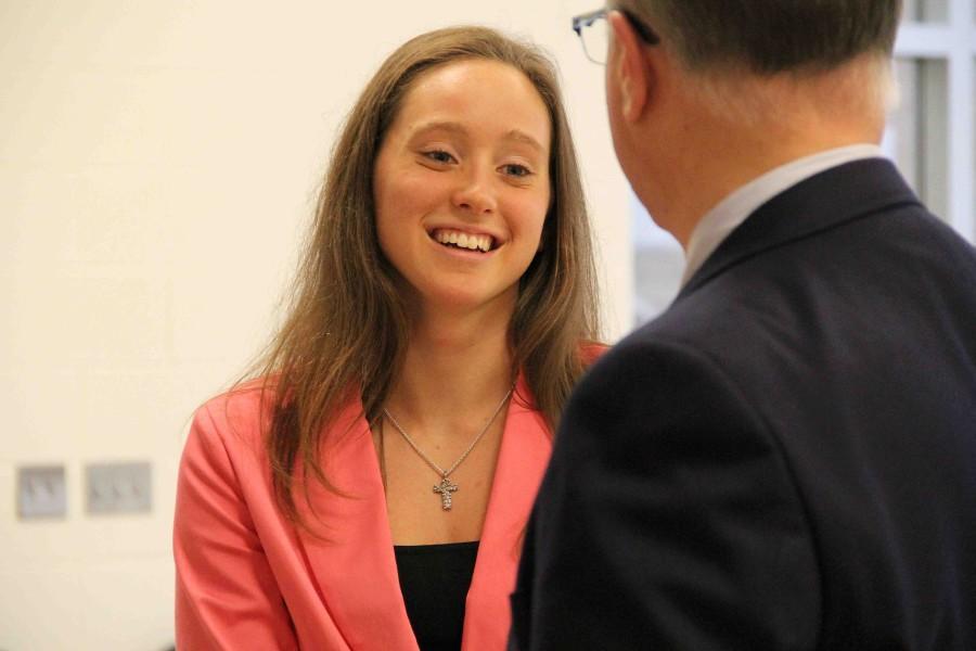 After the ceremony, valedictorian Sara Wujciak shares friendly conversation with Principal Mark Suchowski.