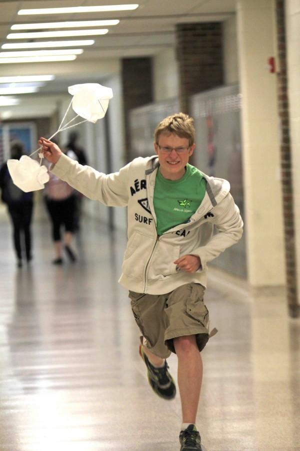 Testing out his group's homemade parachute, sophomore Jake Gutzeit works on his rocket project for CADD. Students are given more points the longer the rocket is in the air, leading many to the same solution as Gutzeit's group.