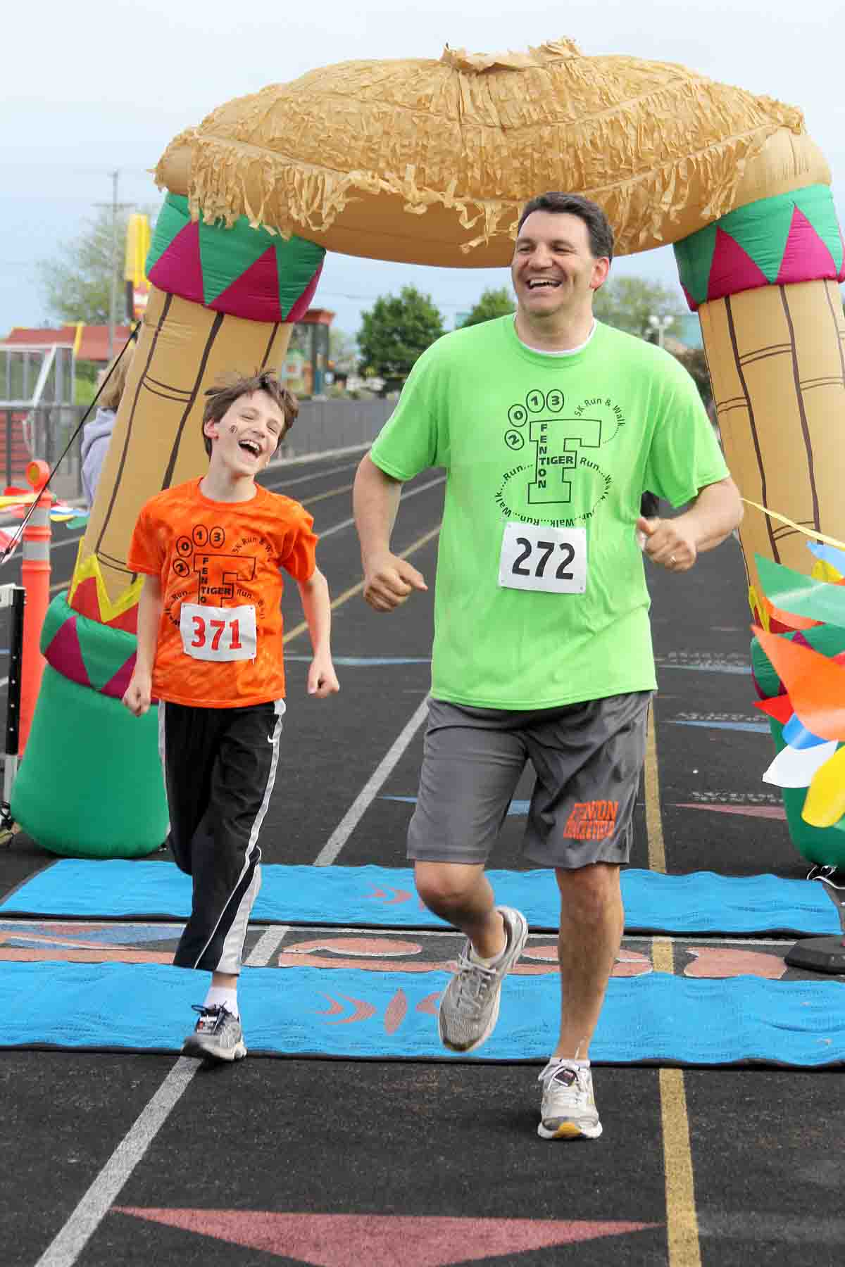 Athletic Director Mike Bakker races his son to the finish line at last year's third annual Tiger Trot.  The 2014 event will take place on May 17.  Races begin at 8:30 a.m. and will be finished by noon.