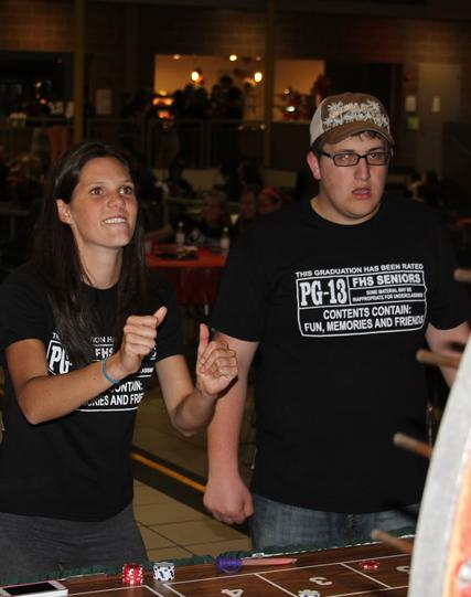 Gambling, now alumni Allison Strayer and Jacob Rositano take part in one of the many casino themed games at Project Graduation 2013.
