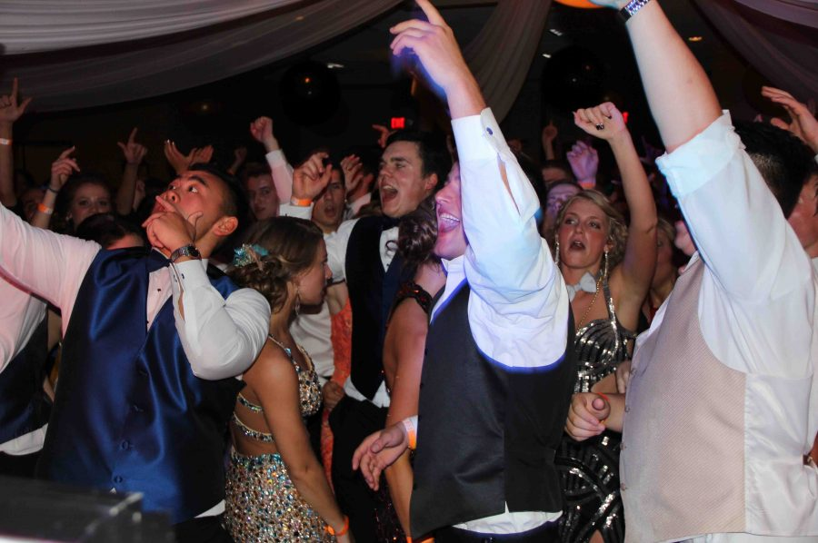 "Senior Year. Surrounded by his friends, senior Justin Hang dances at prom. ""It was my first prom, and it was great,"" Hang said. ""The DJ did an awesome job, I had an amazing date and I was really getting into it, so it was one of my best high  school experiences."""