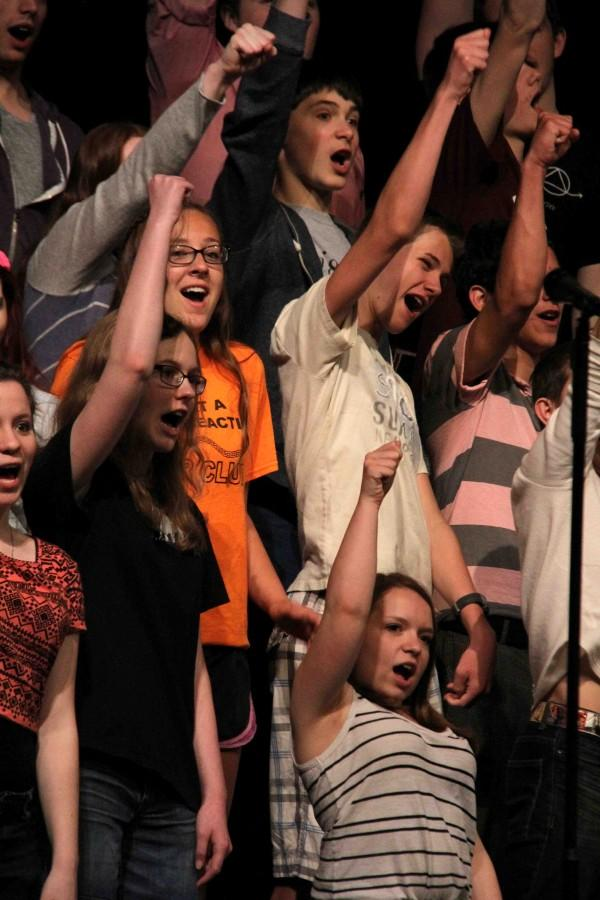 All three choirs practiced in the auditorium before their concert in May. It was their last performance of the year.