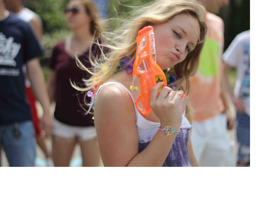 """Senior Year. Waving her beach day weapon, Senior Sydney Pellom participates in the senior beach day prank during fourth hour. """"I was one of the few people who brought a water gun for the senior beach day,"""" Pellom said. """"I goofed around and shot people with it. This prank made me realize that this was the beginning of the end."""""""