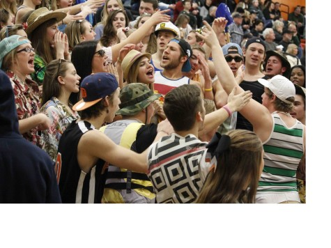 "Senior Year. On Beach Day, senior Landon Mikulenas cheers in the student section. ""It was cool being the senior and starting cheers and participating in themes,"" Mikulenas said. ""The themes were new this year and it seemed like lots of other schools started doing it too."""
