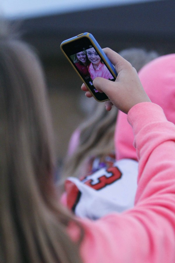 Hanging out at the pink out football game, freshmen Kelly Canning and Syd Stossel take a selfie to remember the memories.