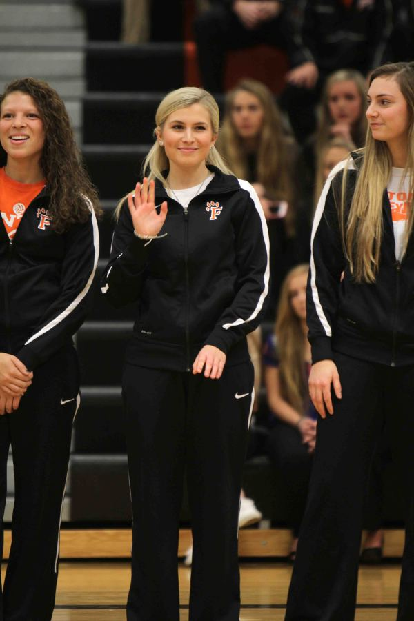 Junior Madi Shegos waves at the crowd during meet the team as her name is called from the girls varsity basketball team roster.