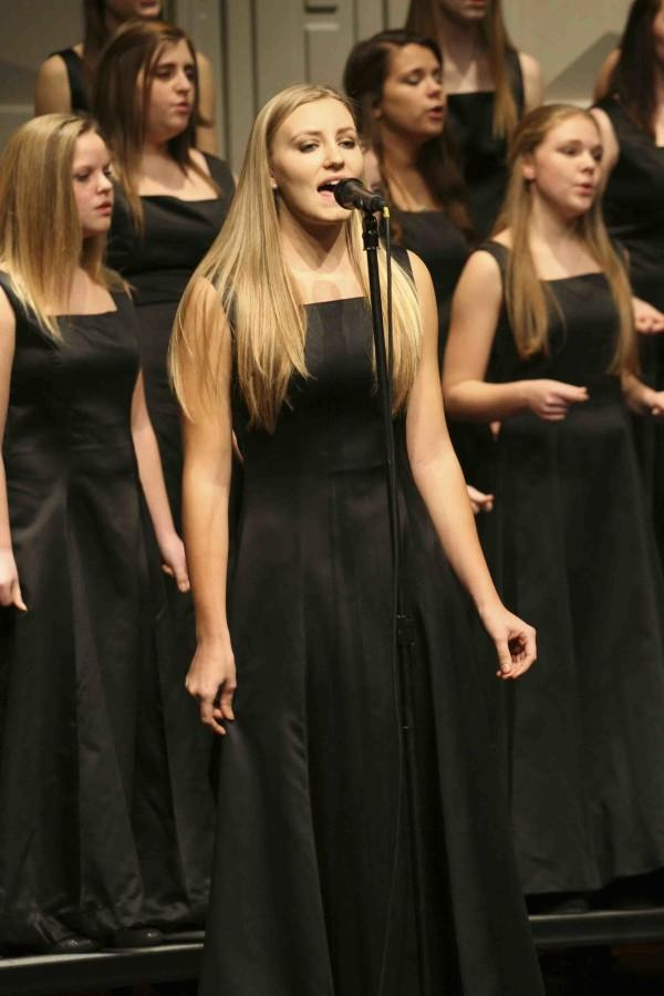 Senior Brianna Madela sings with  the Bella Voce choir during their spot in the Christmas choir.
