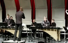 The junior percussion group performs the first piece of the night directed by Yohann Fievet.