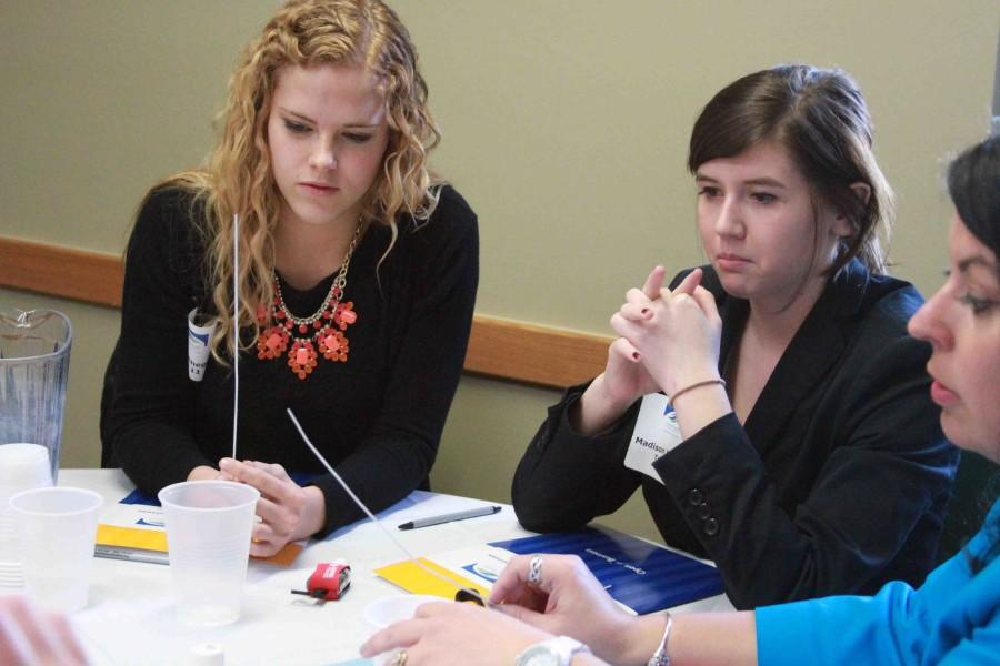 Seniors Rachel Shegos and Madison Wagner participate in a discussion with a local business woman.