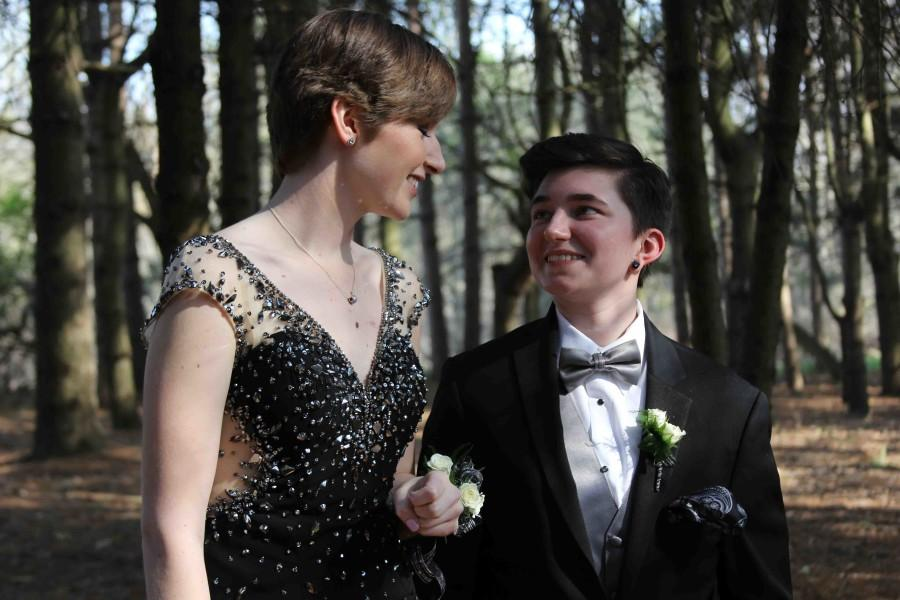 Prom dates, Kaleigh Niles and Peyton Carlo admire each other before their final prom. This year the theme was