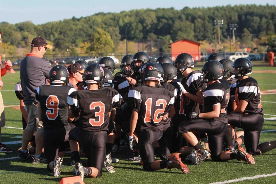 The freshman football team receives direction from their coach before the game. The next freshman football game is home on Thursday, Sep 24 at 4:30 p.m.