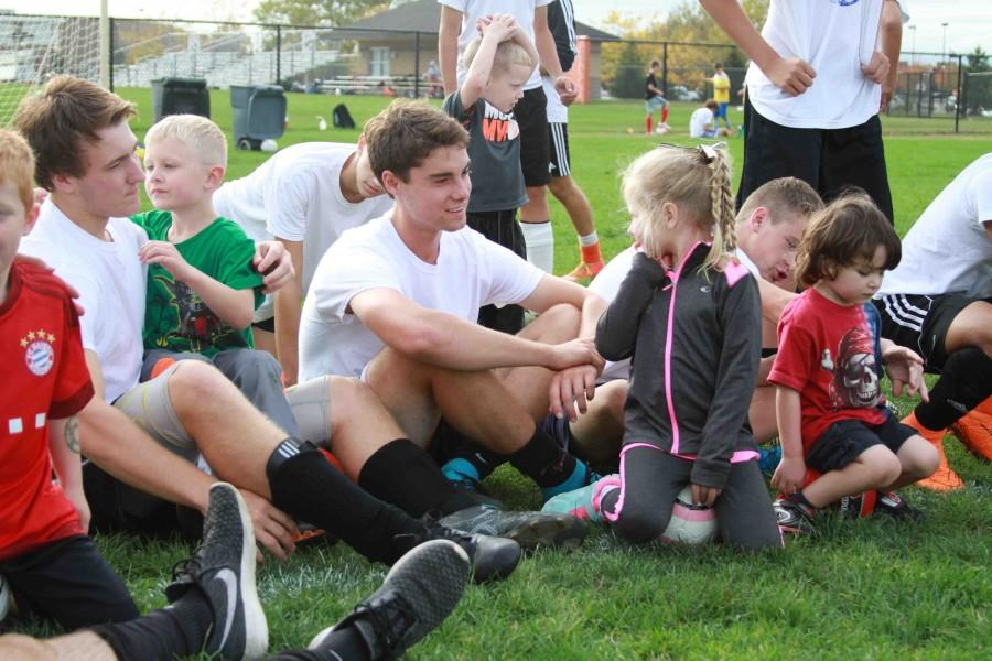 Senior Jake Martin is about of the Boys varsity soccer team. Every year the Fenton Soccer program hosts a Little Tigers club on the JV soccer field to teach young soccer players.