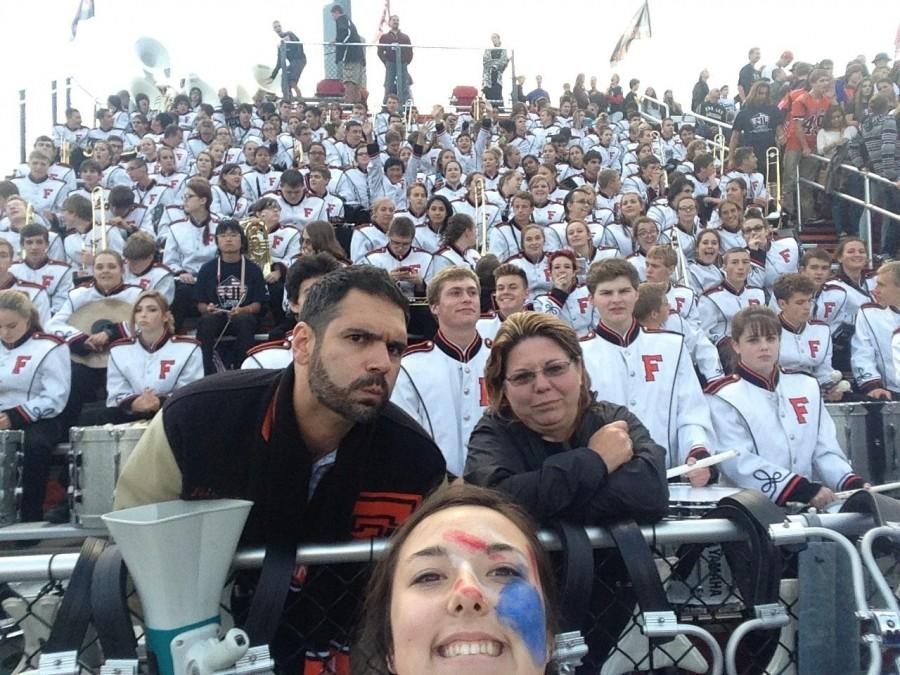 As the band leans in, senior Emily Kinser holds the button on her selfie stick to capture one of her favorite high school memories. I wanted to take something that I could look back on and remember, Kinser said. It was the last first week of high school well ever have. I also wanted to be the first person to get the whole band in one selfie while at a game.