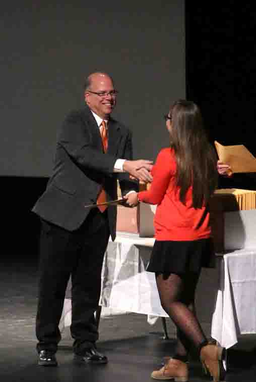 Principal Mark Suchowski presents junior Emily Deming her academic letter today in SRT.
