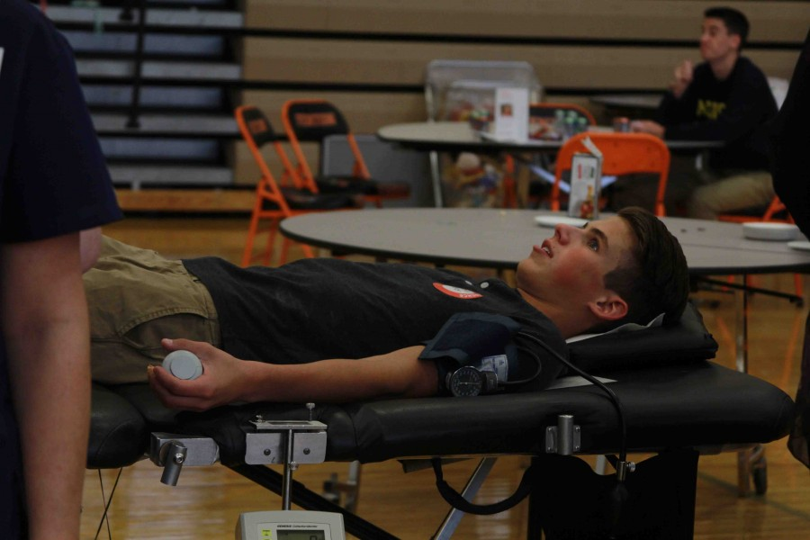 Laying down for the second time, senior Parker Luchenbill waits for his blood to be drawn so it can be donated to the American Red Cross.
