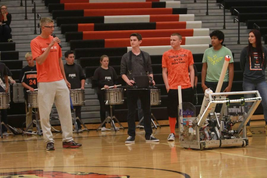 The Titanium Tigers present their newest robot at the pep assembly on Friday.