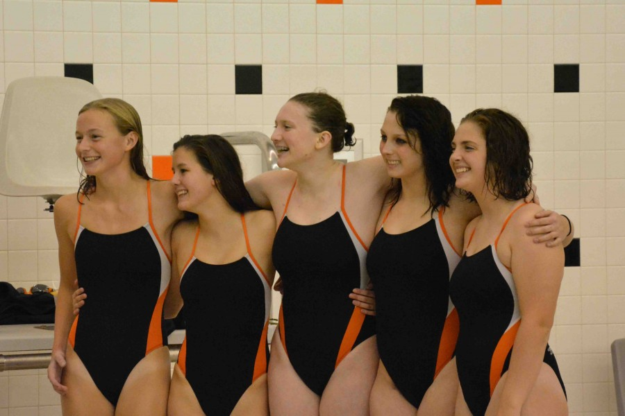 Swimmers celebrate their senior leaders at last meet of the season
