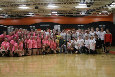 Volleyball and soccer players raise awareness for breast cancer