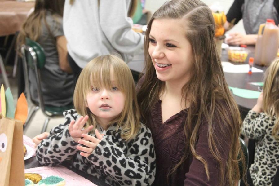 Students bring in young children to celebrate Thanksgiving holidays