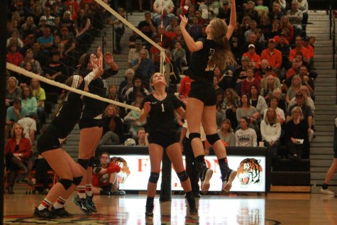 Volleyball teams win against the neighboring rival
