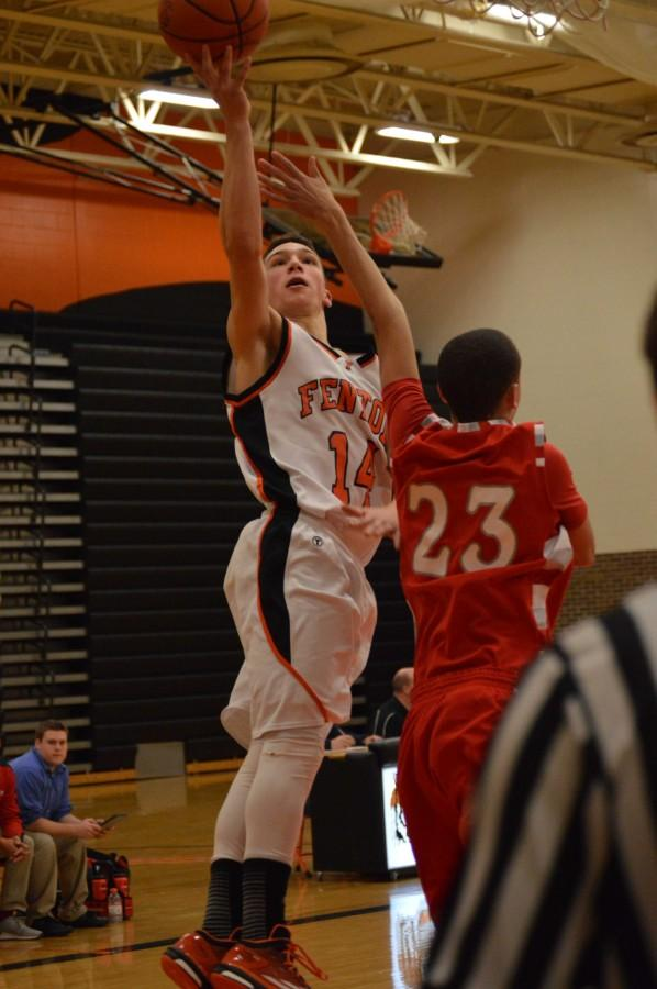 Sophomore Brandon Bossenberger reaches up to score for the JV boys basketball team. The girls and boys varsity teams will be playing tonight at Holly High School with the girls starting at 6 p.m.