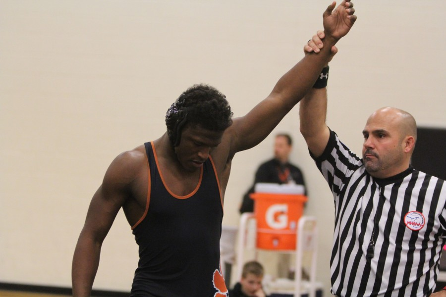 Referee declares senior Joe Williams winner after his match during the wrestling meet this past Wednesday.