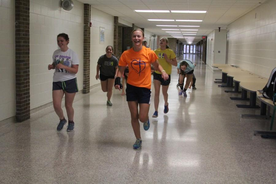 Members of the lacrosse and soccer teams run through drills in the halls.